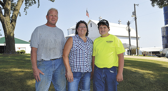 Jon and Wendy Meyer, and their son Karl, installed a Slurrystore in July 2017 to help with manure storage on their 80-cow dairy near Lake City, Minn.  PHOTO BY KRISTA KUZMA