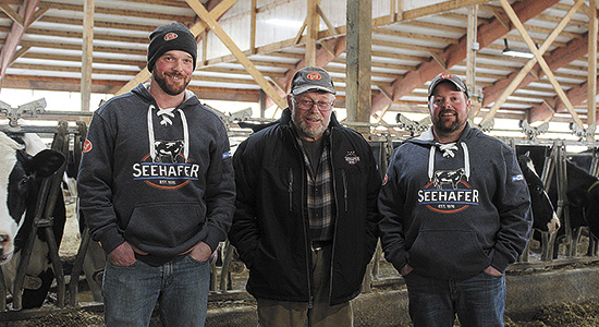 Jake, John and Jason Stueber of Stueber Farms installed six Lely A5 robots on their farm last January as an answer to labor and efficiency struggles. With the installation of the robots, the Stuebers have been able to reduce their workforce, eliminating the need to manage employees. PHOTO BY DANIELLE NAUMAN