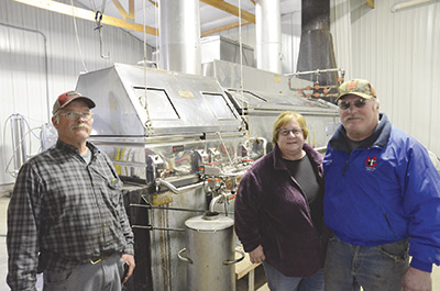 The Staats family – (from left) Ken, Deb, and Ed – own and operate CVF Maple, which produces about 1,000 gallons of maple syrup every year. The business is located at Country View Farms, the dairy run by Ed and Deb, who milk 450 cows and crop 2,000 acres near Sturgeon Bay, Wisconsin. Not pictured is Ken's wife, Margie. PHOTO BY STACEY SMART