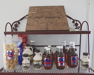 The Staats family sells maple syrup in various sizes as well as specialty items like maple caramel corn, pancake mix, granola and coffee. PHOTO BY STACEY SMART